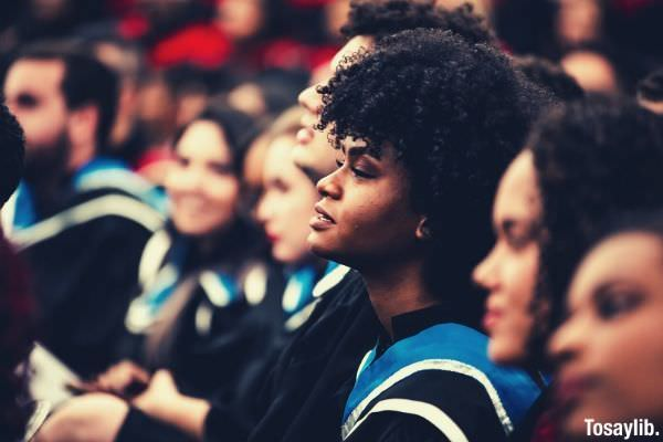 group of people at their graduation rites woman focus curly hair