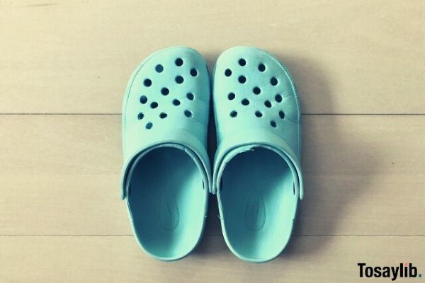blue crocs like sandals on tile floor