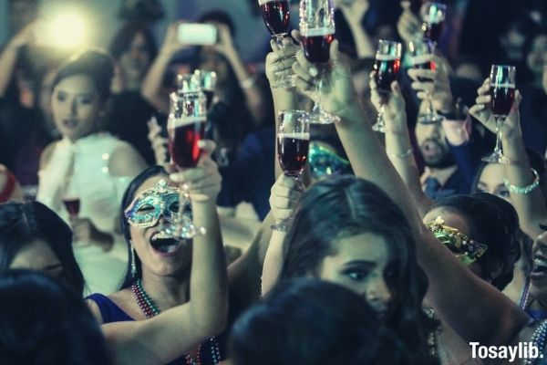 group of women raising champagne flutes mask