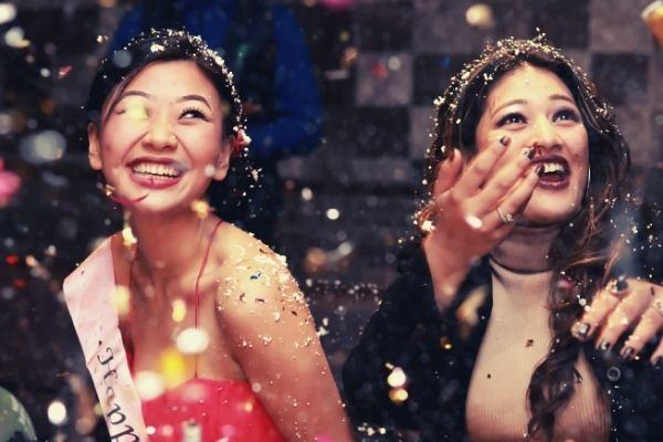 feature-girl-in-red-short-birthday-wishes-happy-confetti-beside-another-girl