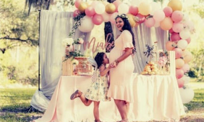 feature-little-girl-kissing=tummy-mother-pregnant-pink-dress-baby-shower-wishes-party (1)