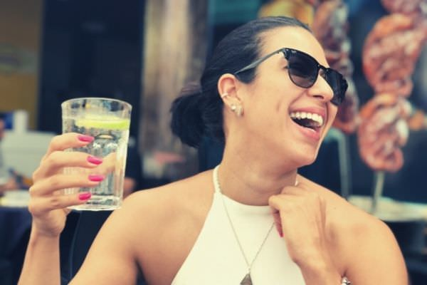 woman-in-rayban-shades-having-friday-drinks-after-work-happy-TGIF