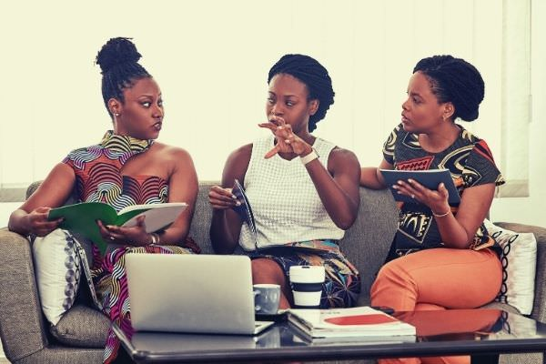 three-black-women-talking-to-each-other-words-to-describe-company-culture