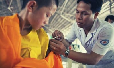 feature-boy-in-temple-dress-getting-a-vaccine-thank-you-after-surgery