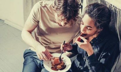 feature-couple-eating-pancakes-on-the-white-floor-words-to-describe-taste