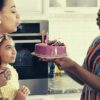 feature-woman-blowing-birthday-candles-happy-family-ways-to-say-happy-birthday