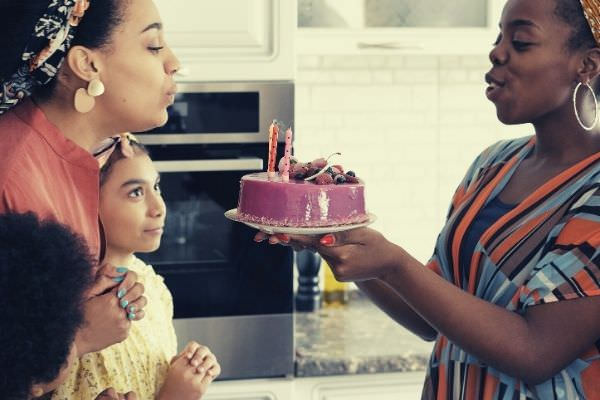 woman-blowing-birthday-candles-happy-family-ways-to-say-happy-birthday