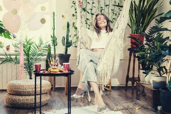 feature-woman-in-white-sitting-on-a-hammock-instagram-captions-for-21st-birthday