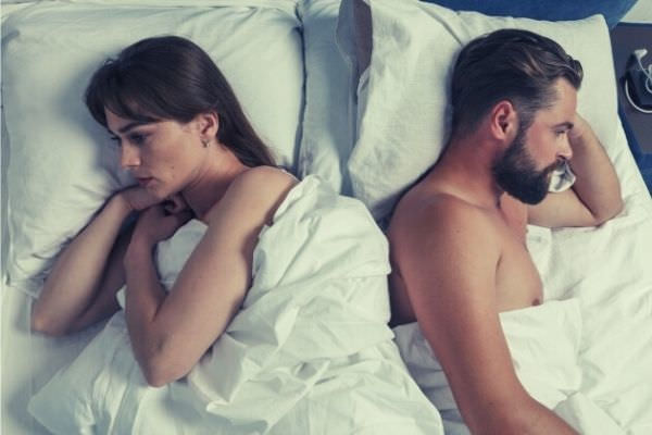 feature-woman-man-quarrel-not-talking-signs-of-partner-cheating-bed