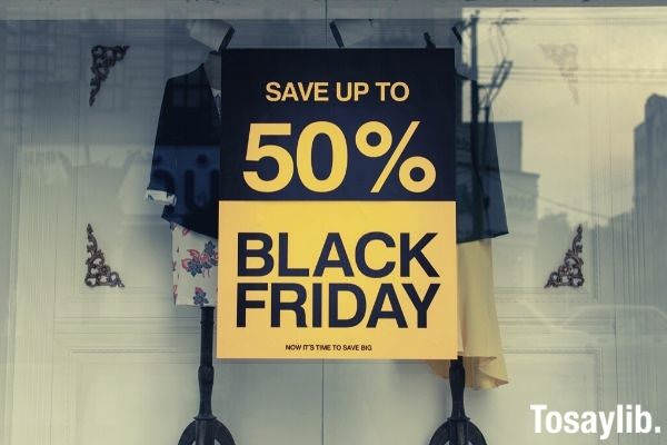 save up to 50 percent black friday sale signage on the glass panel