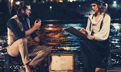 man-and-woman-respond-to-pick-up-line-sitting-on-brown-wooden-dock-during-night-time-eiffel-tower
