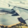 airplane-window-seat-view-flight-sky-and-field