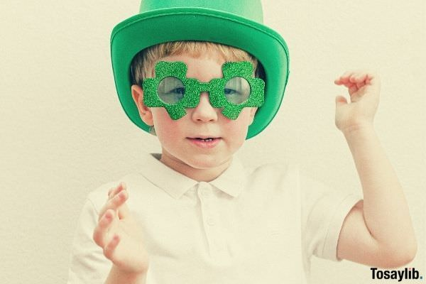 child in saint patrick s day costume white background