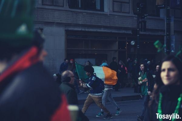 people saint patrick s day man holding indian flag while walking