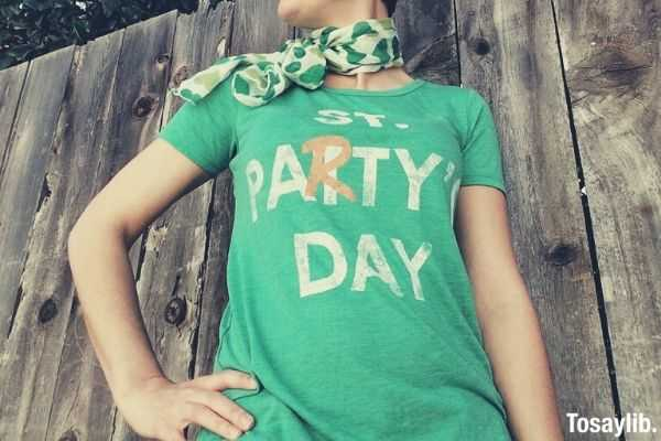 saint party s day green shirt woman wood background
