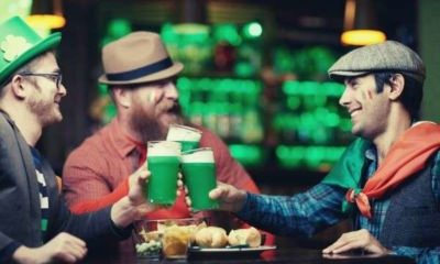 friends-at-a-bar-cheering-Saint-Patrick-s-Day-caption