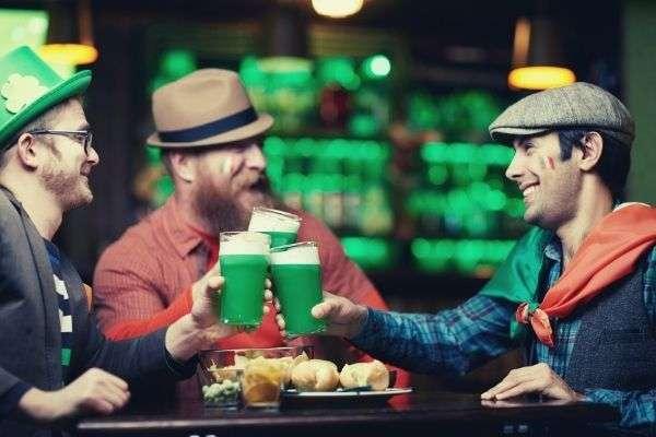friends-at-a-bar-cheering-Saint-Patrick-s-Day-caption