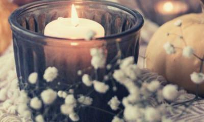 ways-to-say-rest-in-peace-lighted-candles-on-blue-glass-bowl
