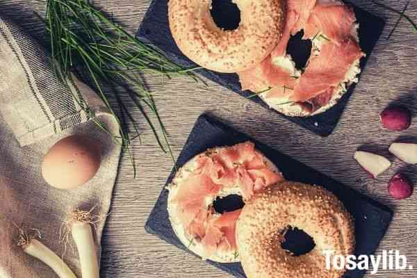 food photography bagel with salmon on top of table flatlay