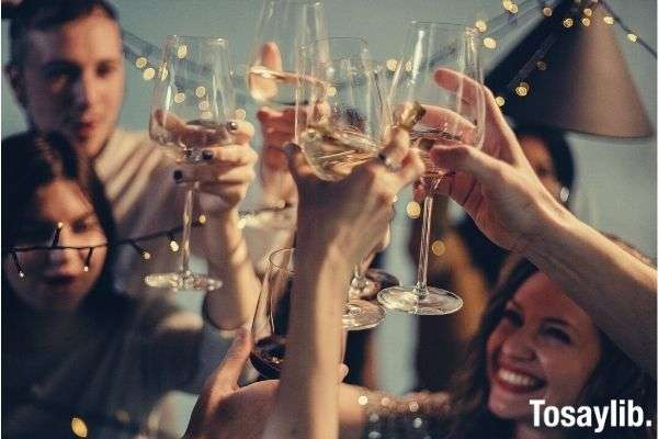selective focus photography of several people cheering wine glasses happy celebration new year