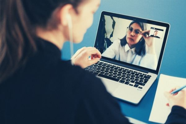 woman on a video call excuse to not video call someone