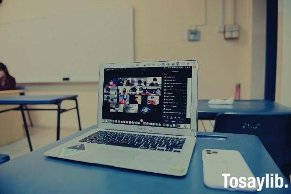macbook pro on blue table photo classroom