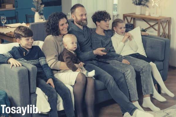big family photo sitting on the sofa