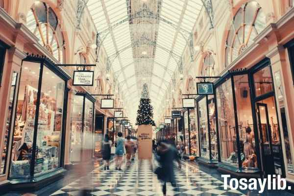 people walking inside mall building near shops photo