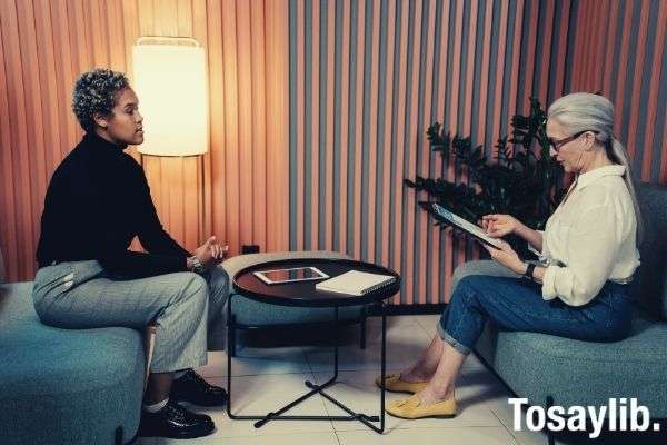 woman in black shirt and blue denim job interview