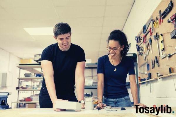 engineers in workshop man and woman