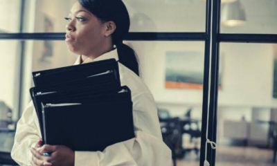 serious-black-woman-carrying-documents-in-office-ask-for-time-to-consider-job-offer