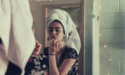 woman-putting-makeup-in-front-of-mirror-words-to-describe-lips