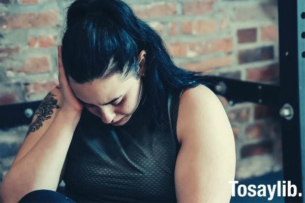 crying woman feeling tired sitting