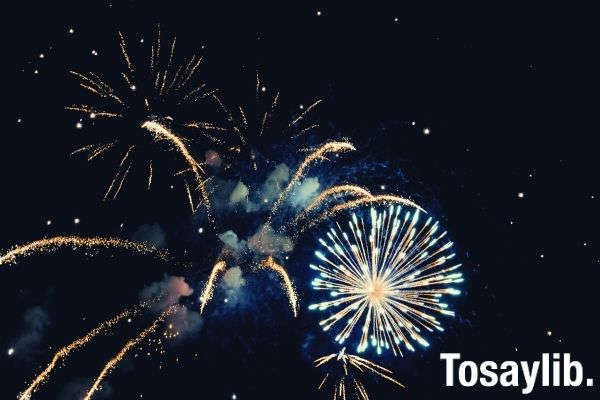 photo of blue white yellow fireworks during nighttime