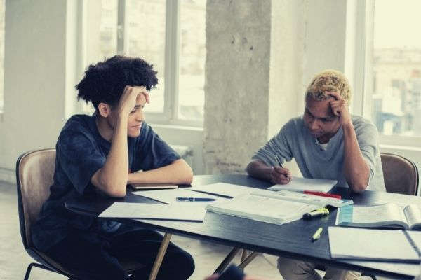 concentrated-black-men-studying-at-table-colored-hair-excuses-homework