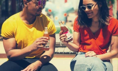 man-and-woman-holding-drink-bottle-while-sitting-excuses-not-to-drink-alcohol