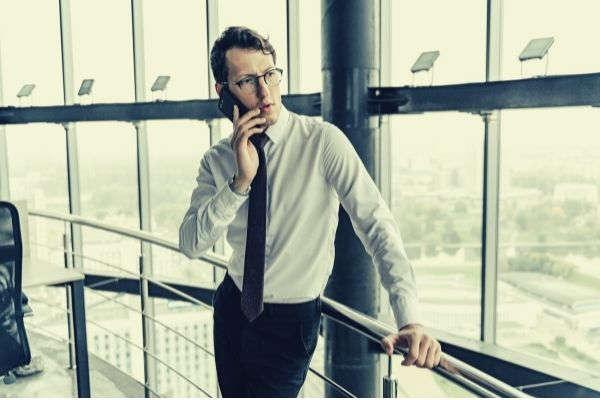 man-in-white-dress-shirt-and-black-pants-wearing-black-framed-eyeglasses-prank-callers