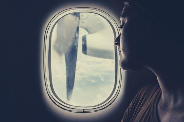 woman-wearing-brown-brown-scoop-looking-outside-the-window-safe-travels