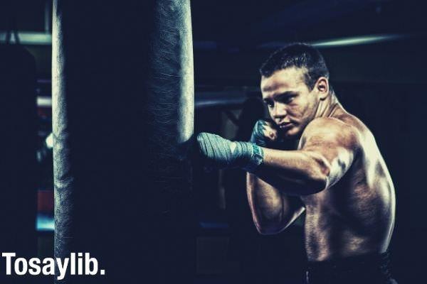 man boxing punching bag punch workout
