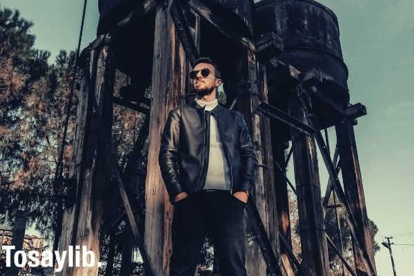 man in black jacket leather jacket