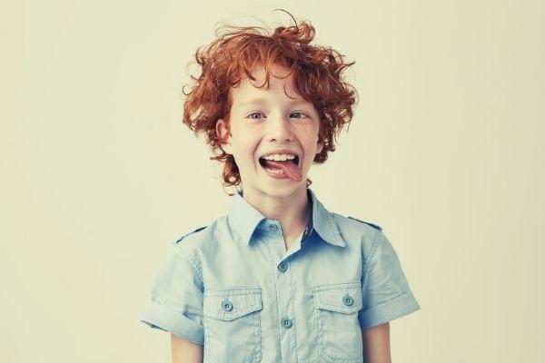 portrait silly little ginger boy blue shirt