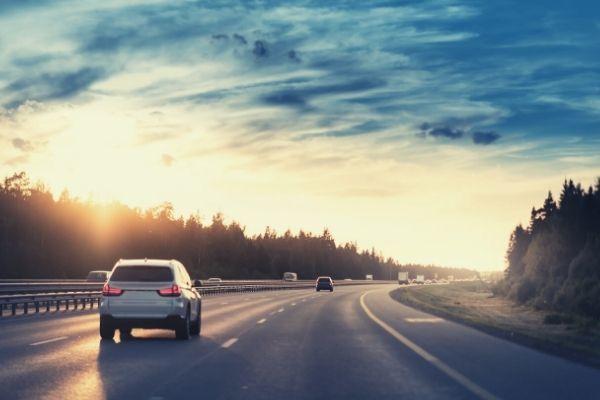 highway car sunset road scene