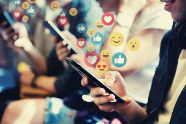 people watching video social media emoticons