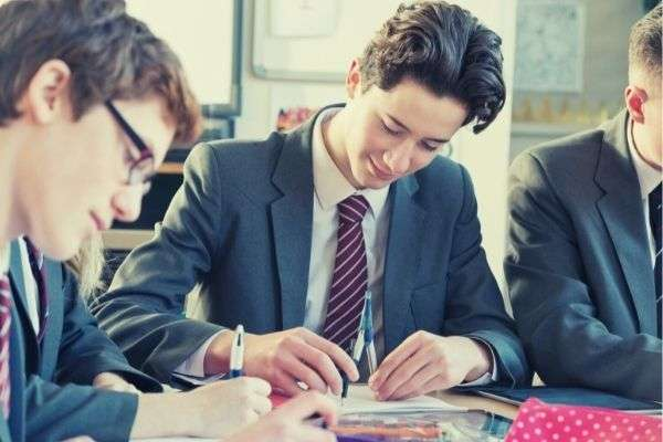 02 high school boy sitting his classmates formal attire