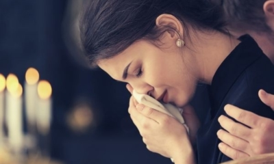 what-to-say-when-you-cannot-attend-funeral-young-woman-crying-wiping-her-tears