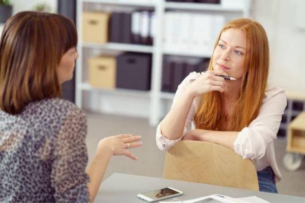 two businesswoman having informal meeting one
