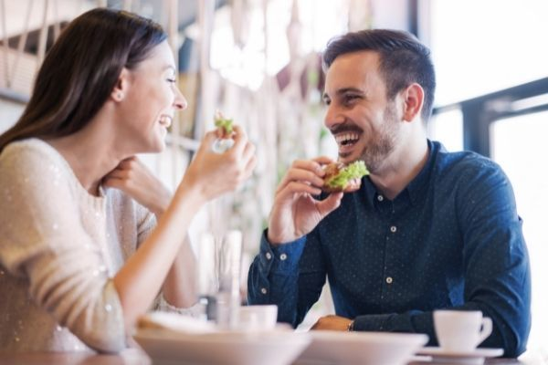 happy loving couple enjoying breakfast cafe smiling food looking at each other