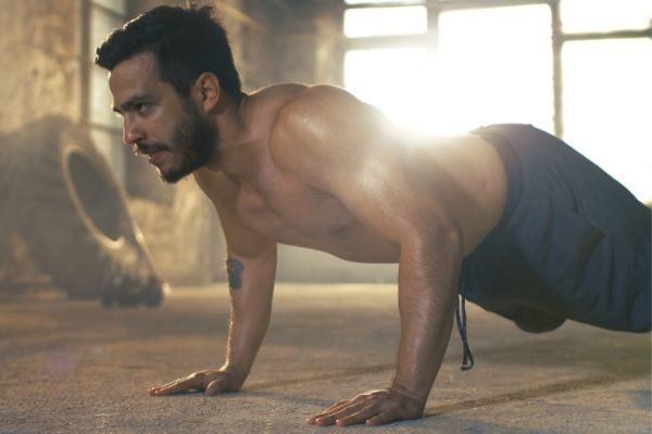 muscular shirtless man covered sweat push up