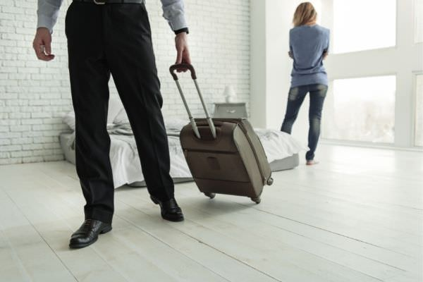 04 male person with luggage walking away from his wife