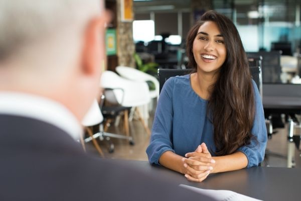 young female candidate laughing job interview